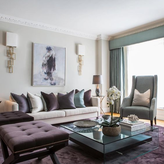 The combination of rich and royal shades of aubergine and celadon green make one elegant living room