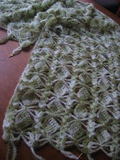 Make a beautiful charmed prayer shawl like this one. Free crochet prayer shawl patterns are lovely when you're making them for a friend or charity. These instructions use UK terms, but translate for U.S.