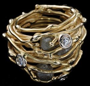 Multi band gold and diamond ring by Boaz Kashi.