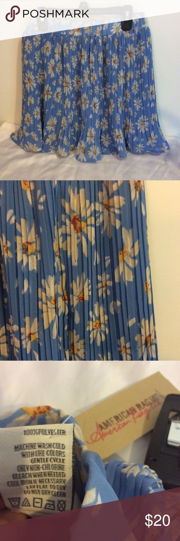 Macy's American Rag Blue Daisy Skirt ~ Size S NWT Macy's American Rag clothing line. Blue skirl with happy Daisy print. Blue slip underneath. Size Small. 100% Polyester. Mashing Wash. Made in China. American Rag Skirts