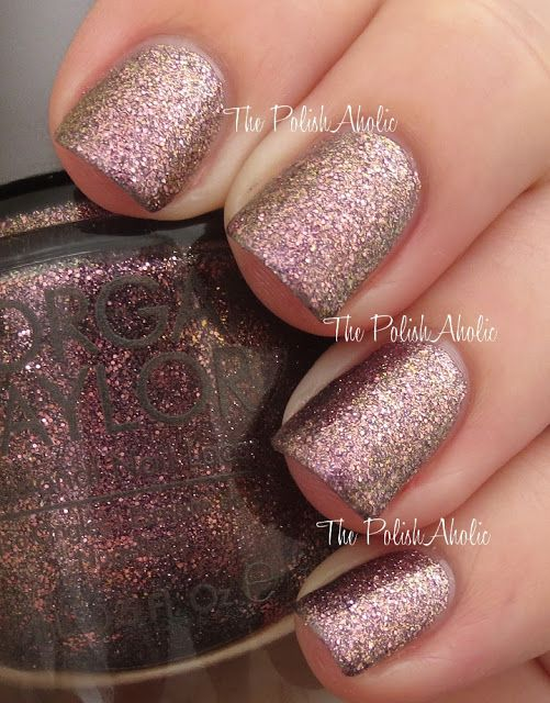 Morgan Taylor Lacquer - Who's That Girl? Used 1 mani. Purple-toned full coverage glitter with pink-gold shift