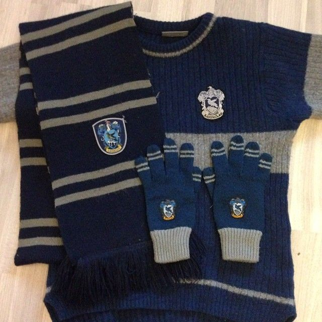 Since I am a Ravenclaw with a lot of Ravenclaw spirit, I have a collection of Ravenclaw clothing items: The scarf, which I ordered on Amazon, the gloves, which I bought in the Harry Potter Studio in London, and the Wool Quidditch Pullover, which I bought in the Platform-9-3/4-fanshop in King's Cross Station in London :) I love the navy and grey colors, they look so nice together