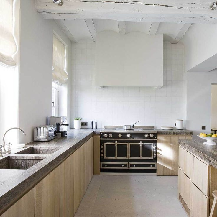 White brick with light floors and brown counters. KITCHEN CLASSIC: Vincent Van Duysen for Obumex