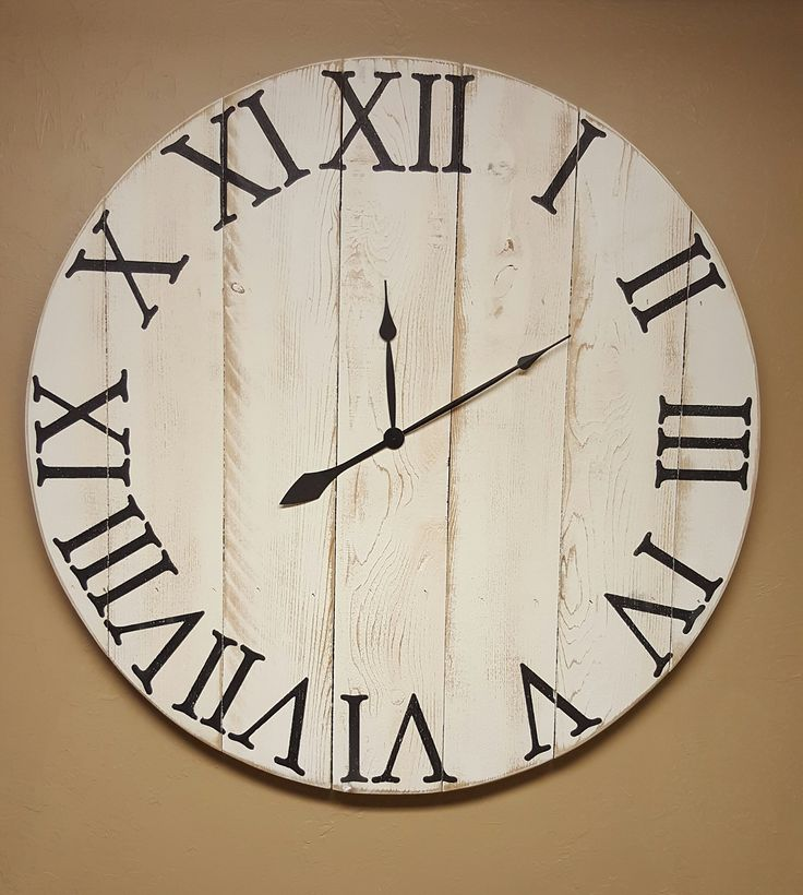 """24in """"Spencer"""" farmhouse wall clock, fixer upper clock with white distressed finish and black roman numerals, shabby chic clock, rustic clock, shiplap clock,. The 24in """"Spencer"""" farmhouse wall clock features vertical boards, a white distressed finish and hand painted black roman numerals. It comes with antique style spade hands, a high torque quartz movement and requires one AA battery to operate (not included.) It also comes with hardware to hang it."""