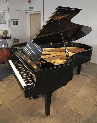 A 1971, Yamaha C7 grand piano for sale with a black case and spade legs at Besbrode Pianos. Piano has an eighty-eight note keyboard and a two-pedal lyre.