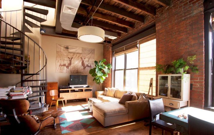 Stunning Open Living Room Decorating Idea with Cream L-shaped Sofa and Retro Area Rug and Cozy Leather Reading Chair and Ottoman also Exposed Brick Wall and Wooden Floor and Wood Ceiling