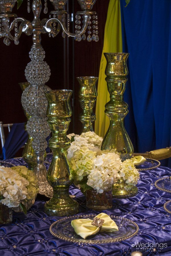 Blue and Green Wedding Tablescapes detailed with Candleholders and Flowers by Perfect Touch Linens