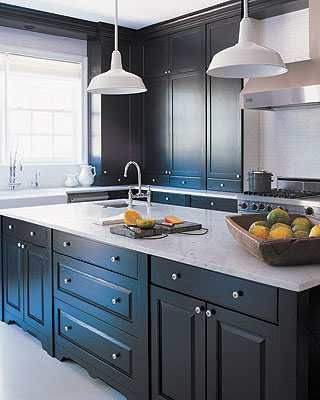 Paint timber kitchen in dark blue grey or white and use laminex faux carera marbel for bench.