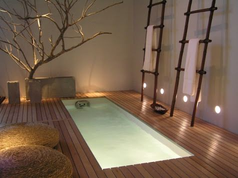 Tubs set into the floor gives a bathroom a nice classy look. These bath tubs come in all sorts of different shapes and sizes. Below are some examples.The below tub was found atwww.guatacrazynight.com, almost gives the tub a pool feel.I LOVE this tub fromwww.designrulz.com! A truly natural, classy tub, that makes one feel like they are in a small piece of heaven.Rain shower head over the floor tub?  Yes please! See more here:interiordesign4.comTh...