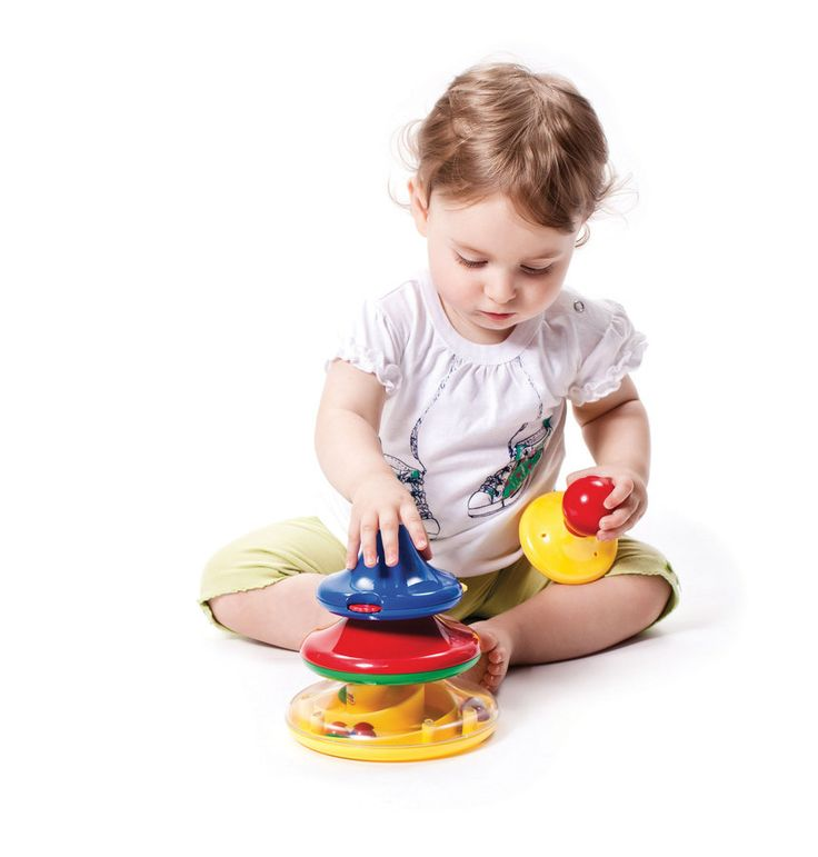 Activity Tower. A stacking toy with an activity in each section plus two rattle sounds. Move the balls around the spiral maze, blow the horn, turn the clicking wheels and press the squeeky top!