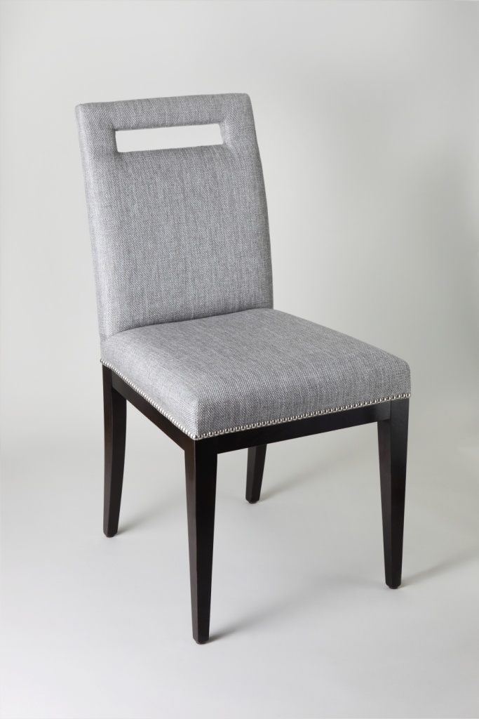 A Sleek And Stylish Contemporary Cut Out Back Dining Chair