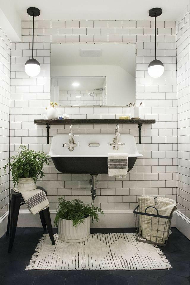 Black and white bathroom style. White subway tile, slack sink basin, black pendant light, stool. #ad #bathroomdecor #wallmountsink