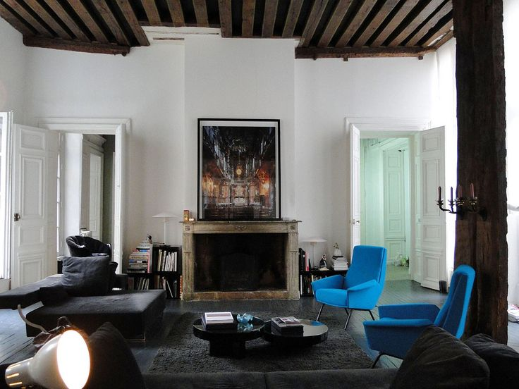 spare living room with rustic fireplace ceiling detail dark