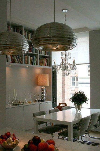 I like the fun silver chrome lights in the foreground as well as the lamp and chandelier!  So eclectic!
