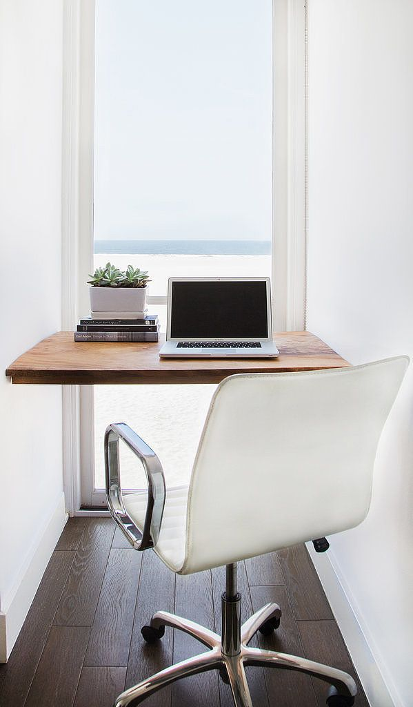 The dilemma: There's hardly room for a desk, let alone a spare bedroom for an office.  The solution: Look for a narrow nook, unused alcove, or any two walls that can support a single floating shelf, and you've got yourself a makeshift desk. This marvelously minimal setup is anything but an eyesore. Source: Tessa Neustadt for Homepolish