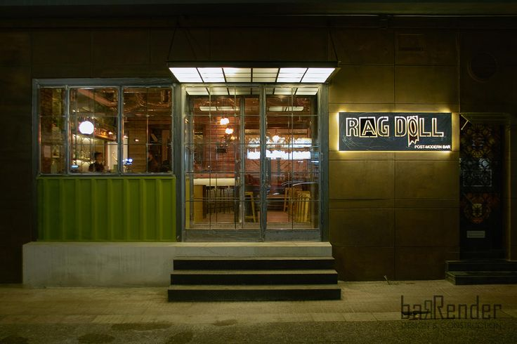 Façade with naked black steel glazing framed with oxidized iron panels - Rag Doll Post modern bar in Athens.