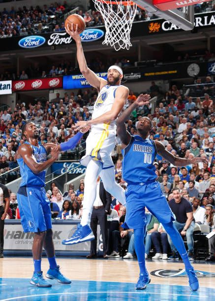 JaVale McGee of the Golden State Warriors drives to the basket against the Dallas Mavericks on October 23 2017 at the American Airlines Center in...