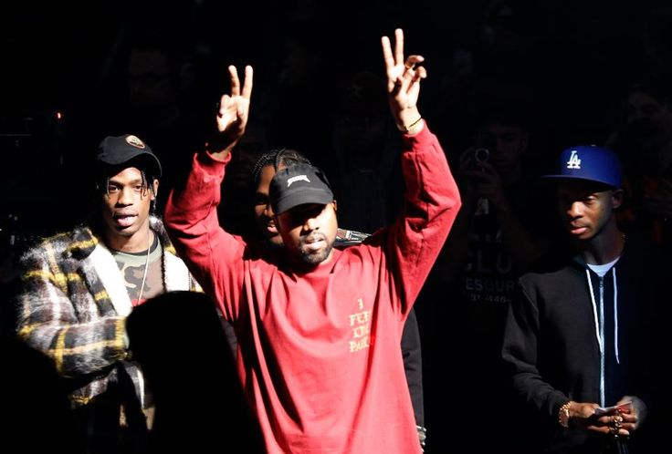 """Kanye West gestures to the audience at the unveiling of the Yeezy collection and album release for his latest album, """"The Life of Pablo,"""" Thursday, Feb. 11, 2016 at Madison Square Garden in New York."""