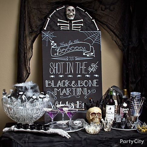 black bone themed halloween bar scene with diy blackboard and boooos y