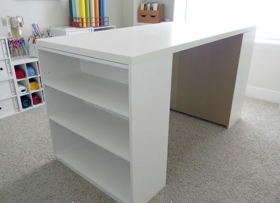 DIY Craft Table... $25 Ikea table top and two $15 bookshelves from Walmart