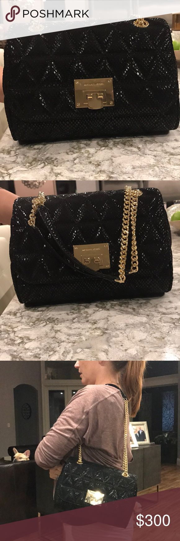 Michael Kors Purse NWT Black MK purse NWT. Dimensions: height is 7 inches, width is 9 1/2 inches, strap can hang 11 inches or 24 inches long Michael Kors Bags