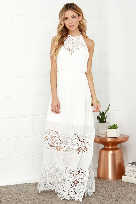 As Seen On Marissa of Style Cusp blog! Lulus Exclusive! A sundress to be reckoned with has arrived! The Dashing Dame Ivory Lace Halter Maxi Dress is sure to be a hit with its tying halter neckline, crochet decolletage, and open back that meets an comfy elastic waistband. Lightweight rayon maxi skirt is decorated with panels of sheer floral lace, making a beautiful and unique silhouette. Lined to mid-thigh.