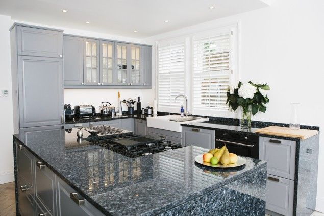 Grey and white IKEA kitchen with black granite worktop and kitchen island, read more here: http://www.mybespokeroom.com/blog/2014/06/04/a-kitchen-for-less-than-10000-the-truth-behind-an-ikea-kitchen/