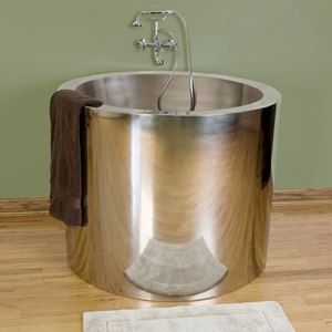 """43"""" Simone Stainless Steel Japanese Style Soaking Tub - Polished Interior/Exterior  Featuring an integral seat and deep interior well, this round stainless steel soaking tub is perfect for creating a spa atmosphere in your contemporary home. The polished finish will add a striking focal point to any bathroom suite. Pair with a wall mount faucet to complete this look.   Description   •  Polished exterior and rim with polished interior.    •  Tub dimensions: 42-3/4"""" diameter x 34-1/4"""" H (±…"""