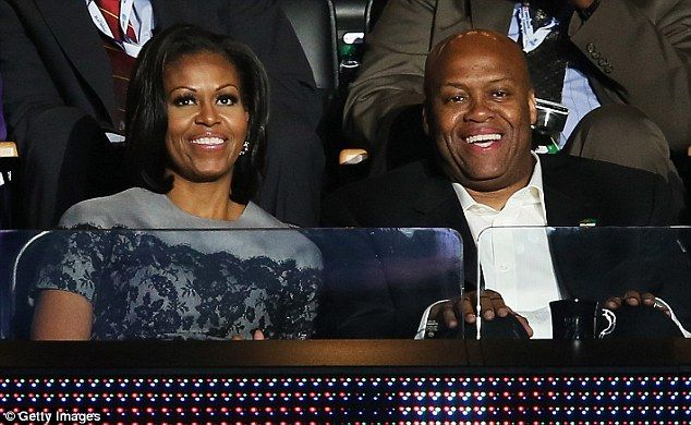 Political connections: Robinson is the brother of first lady Michelle Obama and started at Oregon State the same year his brother-in-law was elected president. Pictured above with his sister at the Democratic National Convention in September 2012