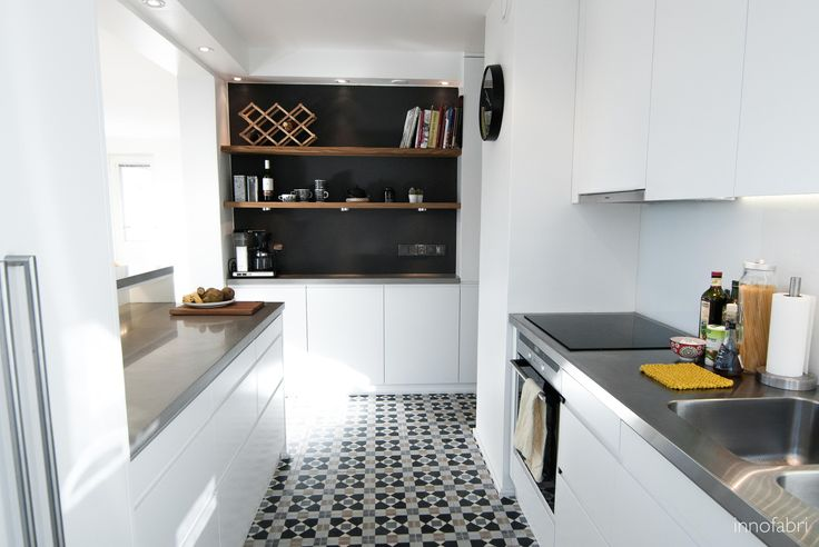 our bespoke white kitchen with patterned tiling