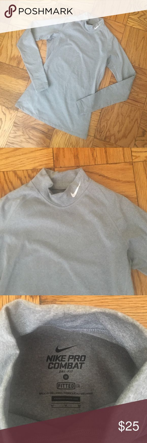 Nike Pro Combat Dri Fit fitted Mock Turtleneck SzM Nike Pro Combat Dri-Fit Fitted Mock Neck Turtleneck Long sleeve. Gray color. Has thumb holes. Great for running outside or skiing. Very warm! Worn once max - in perfect condition. Size Medium. Nike Tops Tees - Long Sleeve