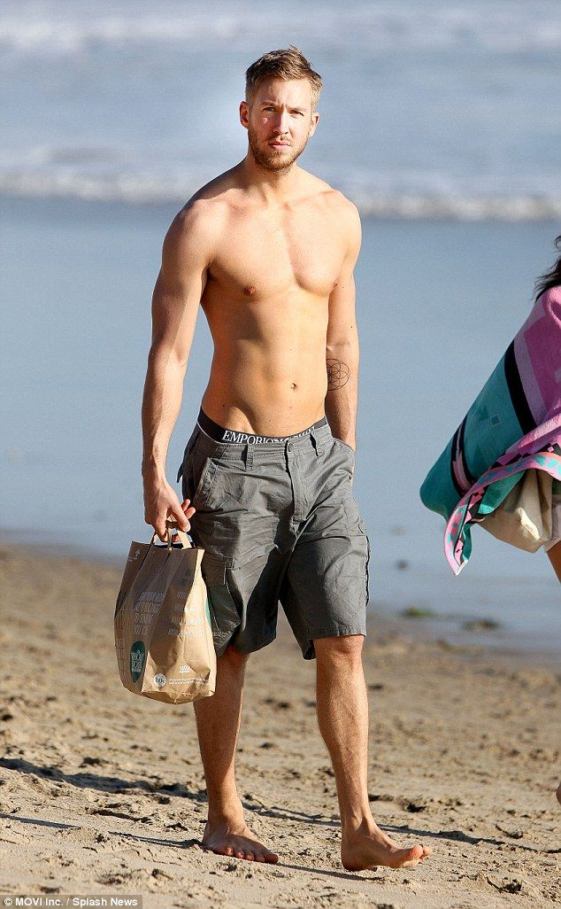 Superstar DJ: Calvin Harris looked remarkable as he strolled down the beach in Malibu while shirtless on Monday