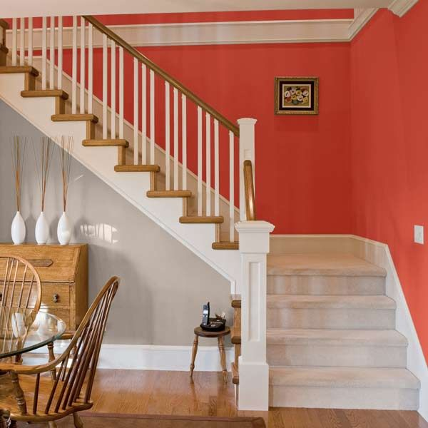 This simple staircase feels grand with a vibrant backdrop. | Azores Rose (B24-1),@Dutch Boy Paint