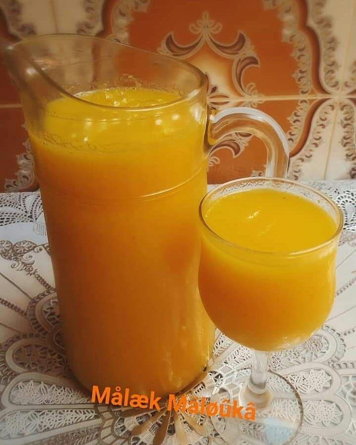 صير البرتقال بكمية وفيرة الوصفة منقووولة مجربة عصير البرتقال عصير عصير برتقال طبيعي عصير طبيعي وصفة جزائرية وصف Hurricane Glass Glassware Tableware
