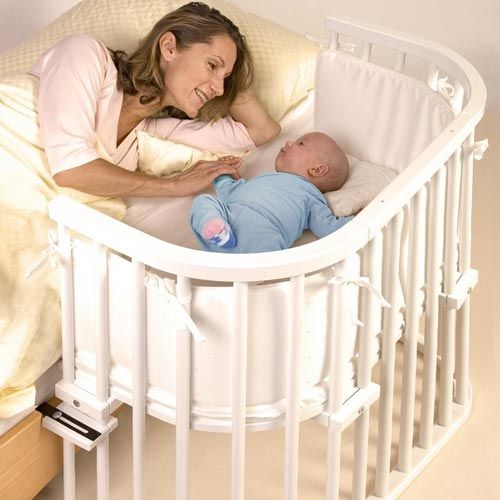 This has to be the coolest crib I have seen, and for a breast feeding mother I can see this being more useful the a bassinet. It is called a BabyBay Maxi Cot.