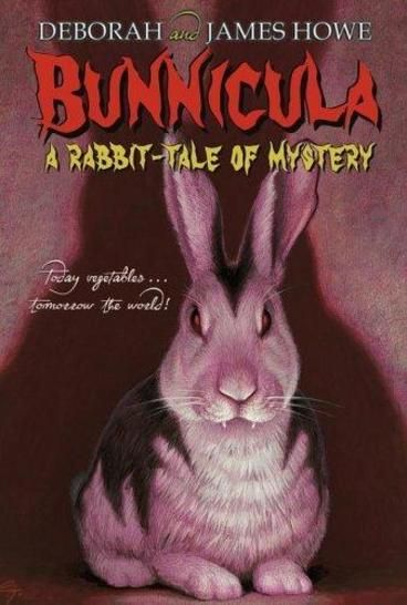 Bunnicula by Deborah Howe.  BEWARE THE HARE! Is he or isn't he a vampire? Before it's too late, Harold the dog and Chester the cat must find out the truth about the newest pet in the Monroe household -- a suspicious-looking bunny with unusual habits...and fangs!