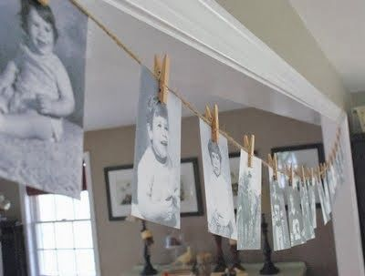 A birthday garland made up of old photographs is a great decorating idea for a 50th birthday.  See more 50th birthday party decorations and party ideas at www.one-stop-party-ideas.com