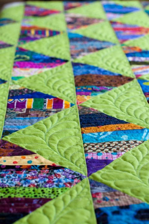 Small strips of scrap fabric were used to make larger quilt pieces. Cool idea! (and the quilting is lovely, too)