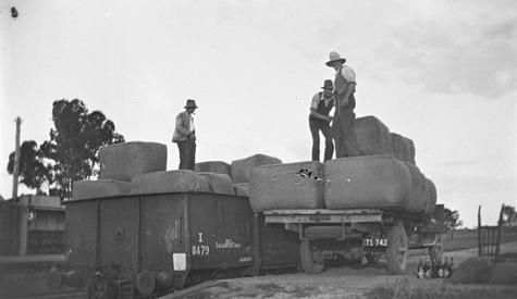Loading wool balesfrom a truck at the Natimuk Railway Station, c1935.
