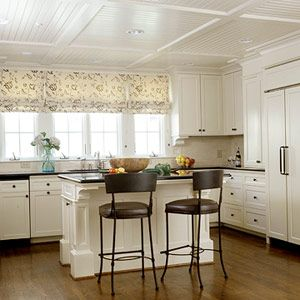 After: Sweet and Spacious white on white with framed cabnet doors, top molding and add decorate molding brackets under cabnets.  Wood flooring