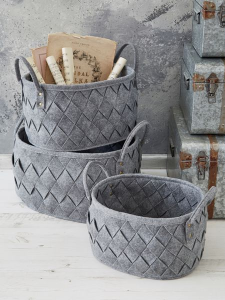 These striking grey woven storage baskets will adorn any space with grace.