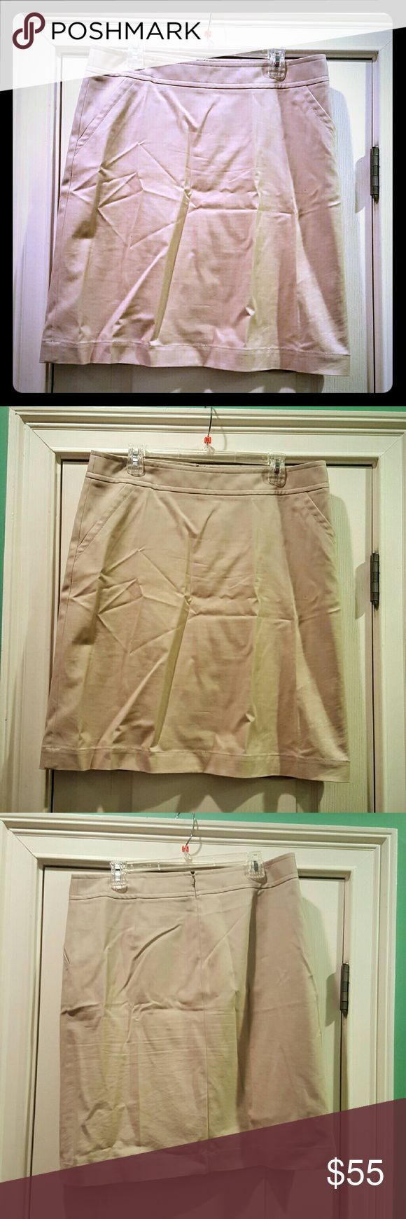 Banana Republic Stretch Khaki Pencil Skirt 14 Tall Excellent used condition Khaki Stretch Pencil Skirt by Banana Republic! Size 14 Tall.  2 front pockets and back zip.  64% cotton,  32% rayon,  4% spandex.  About 23 inches long & 18 inches across the waist. Perfect and comfortable for work or to wear on the weekend. Just been sitting in my drawer so want it to get some use! Reasonable offers and questions welcome! Banana Republic Skirts Pencil