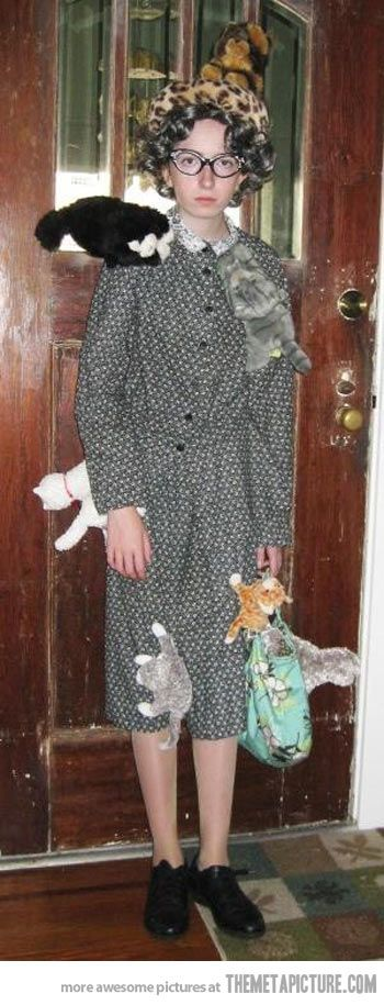Thrift shop dress and repurposed kitties ... lol! LOVE IT!  Crazy Cat Lady Halloween Costume