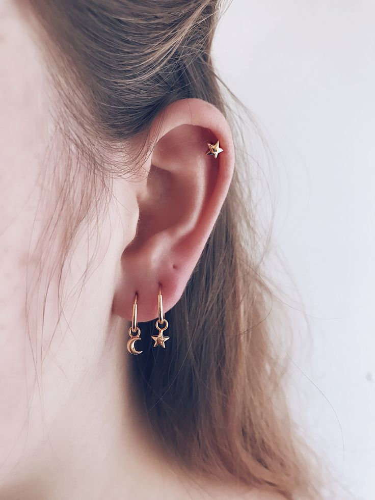 A dainty star and moon adorn your ear lobes in this classic endless hoop earring - Minimal modern and effortless - Stack to create magic on ears - CLICK TO SHOP GOLD STAR MOON HOOPS NOW