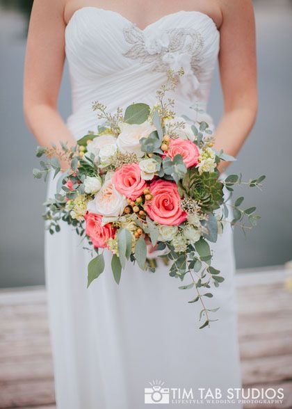 Coral and mint! Garden roses, succulents, eucalyptus, stock etc. Romantic wedding bouquet