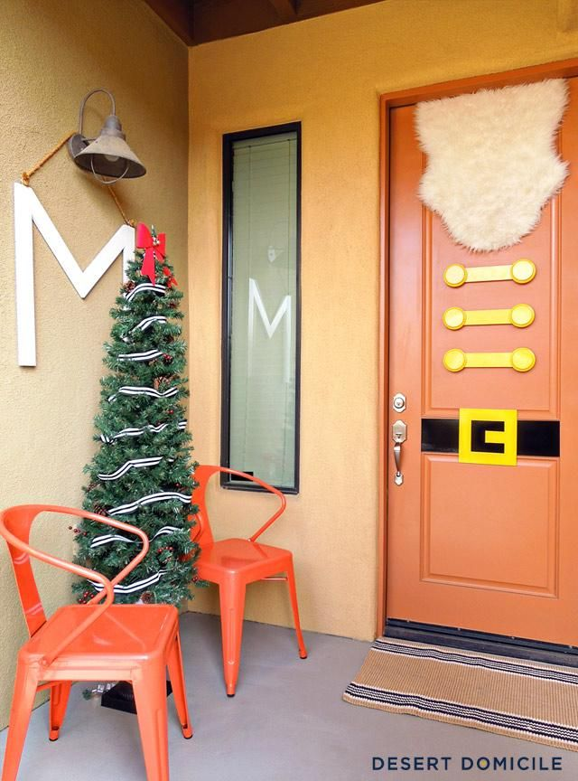 What a clever idea for the front door! (The tree is from Home Depot, by the way.) By @Caitlin Burton Burton @ Desert Domicile