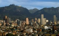 Bogota, Colombia with Monserrate (the white church) in the mountains.