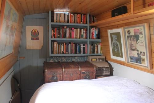 Bedroom with painted bookshelves and door