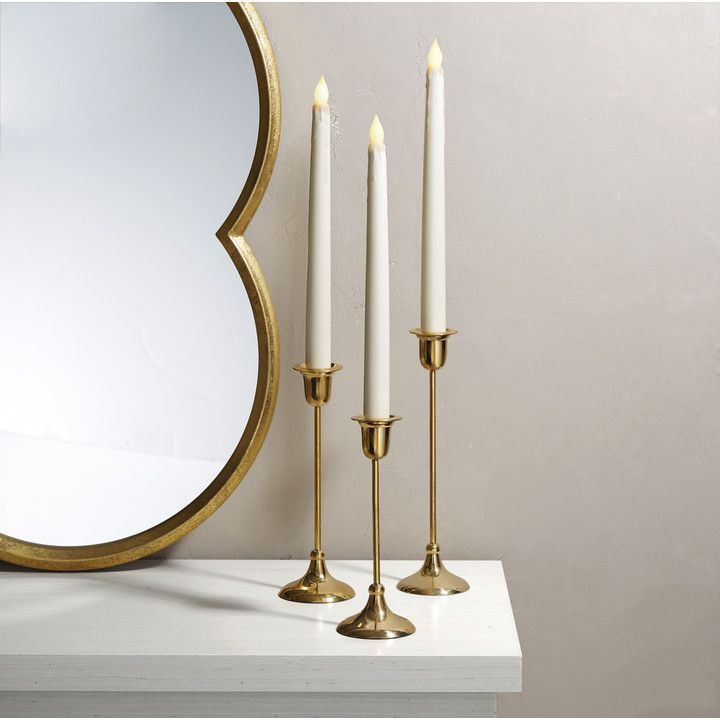Highlight the simple elegance of the taper with our slender, traditional candle holder, crafted from lustrous brass. Arrange a single candle holder among trinkets on a coffee table or arrange multiples of various heights for a dynamic centerpiece. **Please note candles are not included with this product.