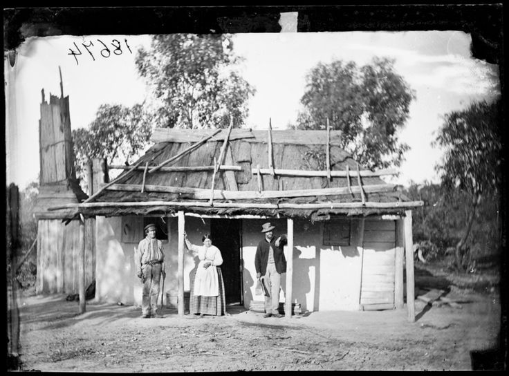 2 men and a woman with bark-roofed, whitewashed house, Hill End, c 1872